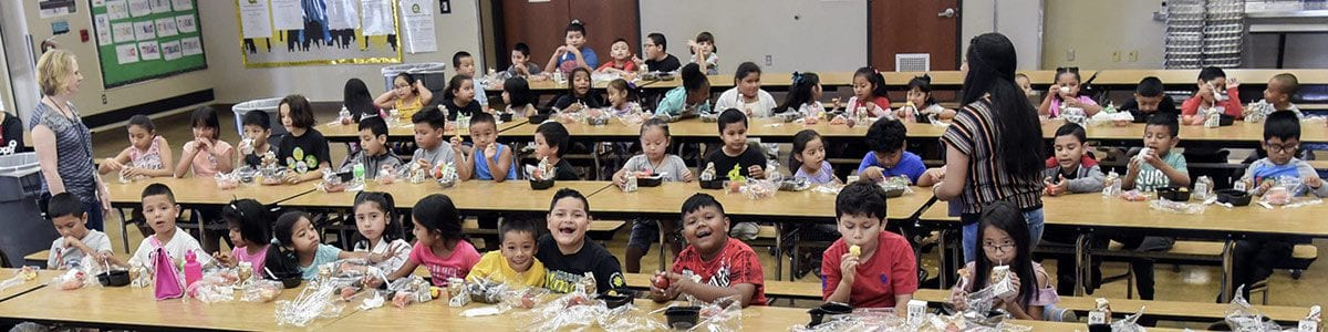 A cafeteria full of young Fresno Unified students eating lunch