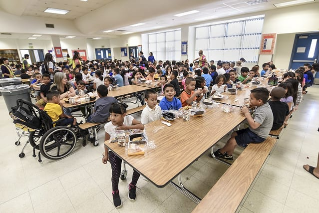 A bustling elementary school cafeteria
